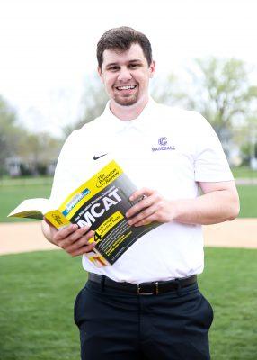 Eric Medenblik, Class of 2021, on Cornell College baseball field, Ash Park