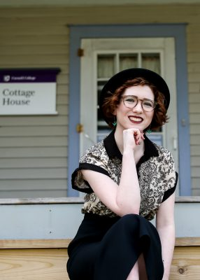 Madeleine Kleckner, Class of 2021, sits on the steps of The Cottage, home to the student organization, TWRG.