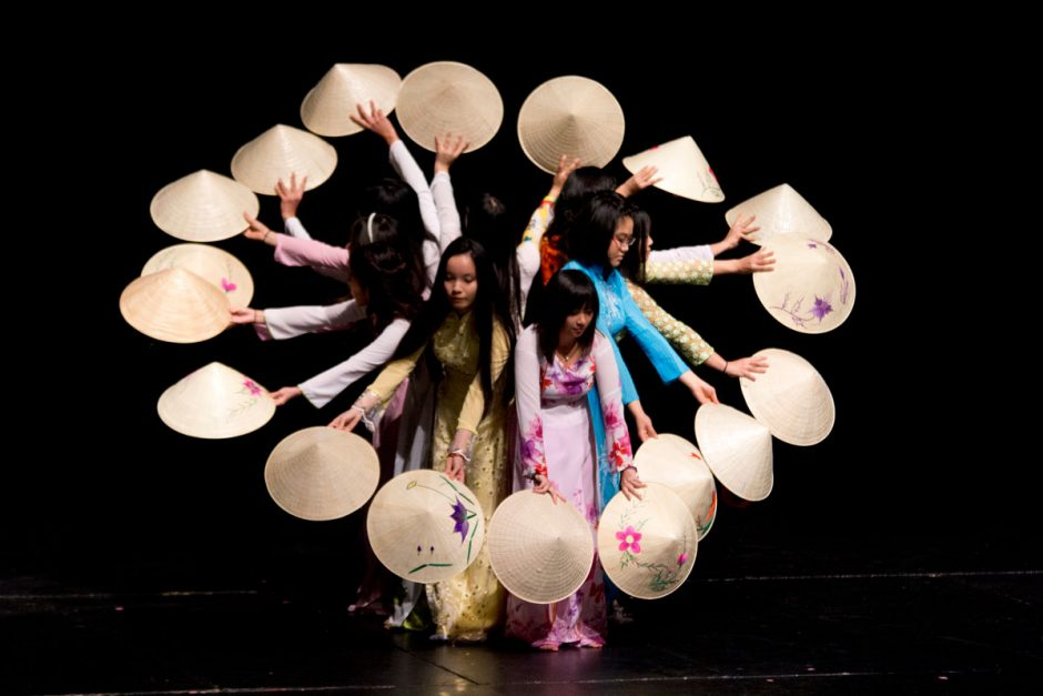 Performing the Vietnamese conical hat dance in 2014 are Linh Nguyen '16, Linda Nguyen '14, Julie Hoang '16 (from center left with faces visible), Anh Pham '16, Ngoc Nguyen '17, Addy Dam '14, Bao-Chau Do '15, Thao Luu '16, and Theresa Dinh '16.