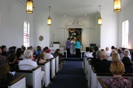 Wedding photo of two people at the altar in Allee Chapel