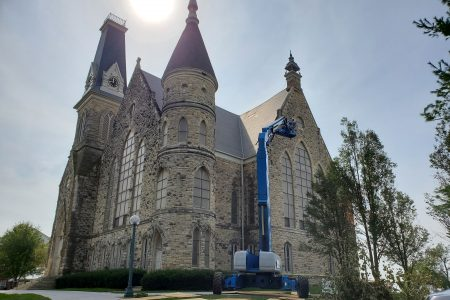 photo of King Chapel with heavy equipment for observing damage