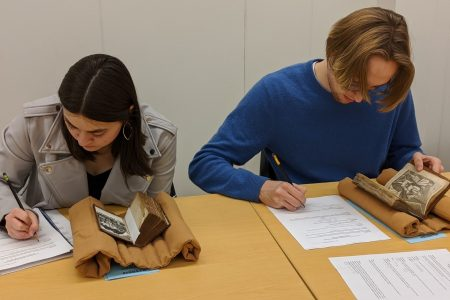 Students took a field trip to the Special Collections at the University of Iowa to look at period texts, recipe books, and journals.
