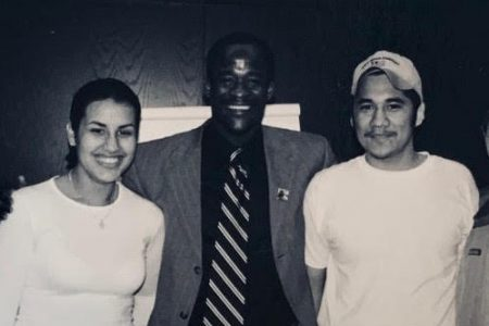 Eddie Moore Jr. '89 (center), founder of the White Privilege Conference, with two work-study students who assisted him in its launch, Laura Gonzalez Muma '03, and Jose A. Suarez '03.