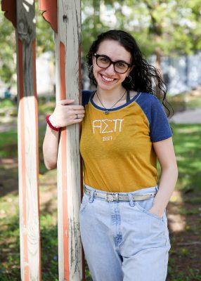 Jenna Makkawy, Class of 2021, near swing by Hanson House