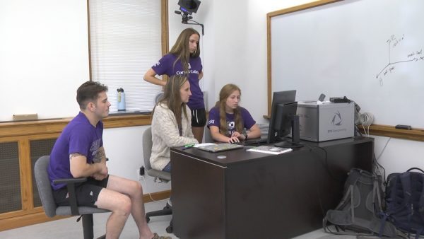Associate Professor of Kinesiology Krisi Meyer (center) works with (from left) Quinten Howe, Rory Light, and Sydney Hancox.