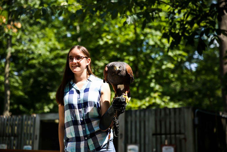 Alina Moore and Saguaro, a Harris's hawk.