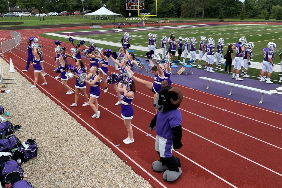 Cheerleaders cheering for the Rams at the first football game of the 21-22 season.