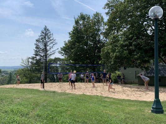 Students participating in sand volleyball during Field Day