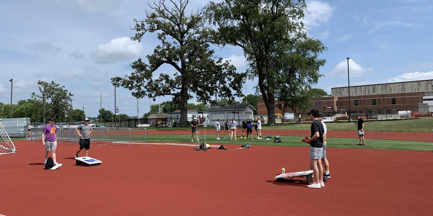 Students play bags during Field Day