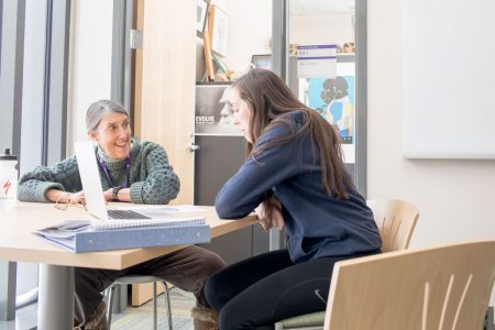 Professor of Biology Marty Condon works with a student outside her office in Russell Science Center.