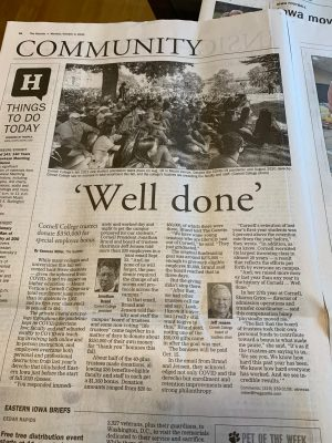 Photo of the newspaper with the headline 'well done'