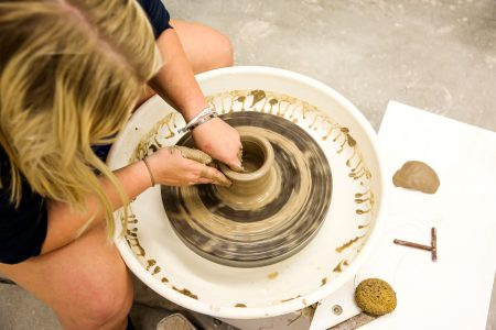 Student working on pottery