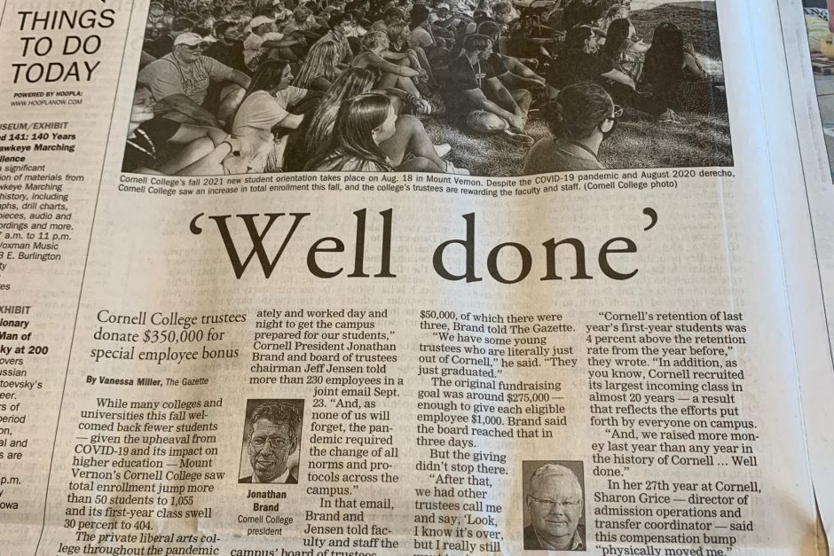 """Photo of the newspaper with the headline """"Well done"""""""